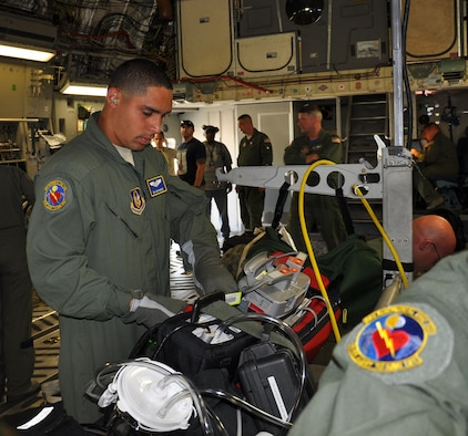 Senior Airman Ian Ramirez, an aeromedical evacuation technician assigned to the 445th Aeromedical Evacuation Squadron, prepares for a training mission on board a 445th Airlift Wing C-17 Globemaster III May 29, 2015. (U.S. Air Force photo/Master Sgt. Carie Brown)