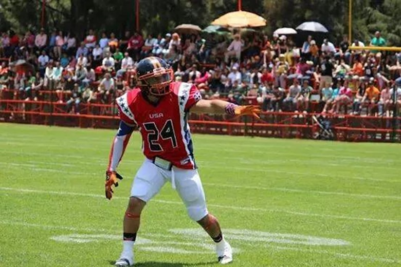 Senior Airman Ian Ramirez, an aeromedical evacuation technician assigned to the 445th Aeromedical Evacuation Squadron, gets ready to catch a pass during a game between the USA Patriots and Costa Rica Bulldogs May 2, 2015. (Courtesy photo)