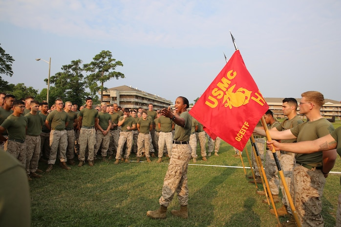 Sgt. Maj. Robin C. Fortner, sergeant major, Ground Combat Element Integrated Task Force,  welcomes Marines and sailors before the task force field meet outside of the Command Post, July 2, 2015. From October 2014 to July 2015, the GCEITF conducted individual and collective level skills training in designated ground combat arms occupational specialties in order to facilitate the standards based assessment of the physical performance of Marines in a simulated operating environment performing specific ground combat arms tasks. (U.S. Marine Corps photo by Cpl. Paul S. Martinez/Released)