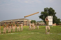 Cpl. Jamie Martz, engineer equipment electrical systems technician, Engineer Platoon, Headquarters and Service Company, Ground Combat Element Integrated Task Force, competes in the caber toss event as part of the task force field meet outside of the Command Post, July 2, 2015. From October 2014 to July 2015, the GCEITF conducted individual and collective level skills training in designated ground combat arms occupational specialties in order to facilitate the standards based assessment of the physical performance of Marines in a simulated operating environment performing specific ground combat arms tasks. (U.S. Marine Corps photo by Cpl. Paul S. Martinez/Released)