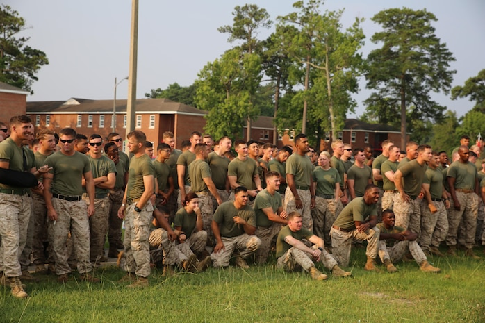 Marines and sailors with the Ground Combat Element Integrated Task Force cheer on their competitors during the task force field meet outside of the Command Post, July 2, 2015. From October 2014 to July 2015, the GCEITF conducted individual and collective level skills training in designated ground combat arms occupational specialties in order to facilitate the standards based assessment of the physical performance of Marines in a simulated operating environment performing specific ground combat arms tasks. (U.S. Marine Corps photo by Cpl. Paul S. Martinez/Released)