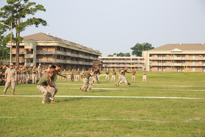 Marines with the Ground Combat Element Integrated Task Force compete in the four-legged race as part of the task force field meet outside of the Command Post, July 2, 2015. From October 2014 to July 2015, the GCEITF conducted individual and collective level skills training in designated ground combat arms occupational specialties in order to facilitate the standards based assessment of the physical performance of Marines in a simulated operating environment performing specific ground combat arms tasks. (U.S. Marine Corps photo by Cpl. Paul S. Martinez/Released)