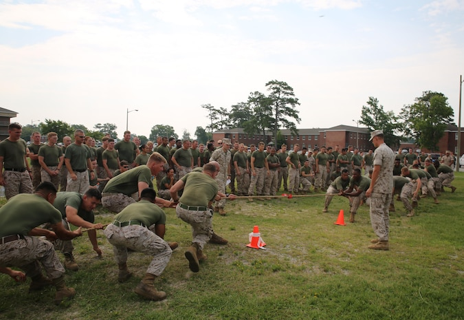 Marines representing Company B, Ground Combat Element Integrated Task Force, left, compete against Marines representing Company A, right, during a game of tug of war as part of the task force field meet outside of the Command Post, July 2, 2015. From October 2014 to July 2015, the GCEITF conducted individual and collective level skills training in designated ground combat arms occupational specialties in order to facilitate the standards based assessment of the physical performance of Marines in a simulated operating environment performing specific ground combat arms tasks. (U.S. Marine Corps photo by Cpl. Paul S. Martinez/Released)