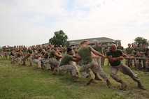 Marines representing Company B, Ground Combat Element Integrated Task Force, pull company team during a game of tug of war as part of the task force field meet outside of the Command Post, July 2, 2015. From October 2014 to July 2015, the GCEITF conducted individual and collective level skills training in designated ground combat arms occupational specialties in order to facilitate the standards based assessment of the physical performance of Marines in a simulated operating environment performing specific ground combat arms tasks. (U.S. Marine Corps photo by Cpl. Paul S. Martinez/Released)