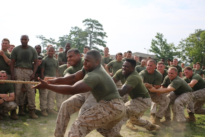 Marines and sailors representing Weapons Company, Ground Combat Element Integrated Task Force, pull for their company team during a game of tug of war as part of the task force field meet outside of the Command Post, July 2, 2015. From October 2014 to July 2015, the GCEITF conducted individual and collective level skills training in designated ground combat arms occupational specialties in order to facilitate the standards based assessment of the physical performance of Marines in a simulated operating environment performing specific ground combat arms tasks. (U.S. Marine Corps photo by Cpl. Paul S. Martinez/Released)