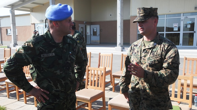 Bulgarian Army Col. Iavor Mateev and U.S. Marine Corps Capt. Michael R. McNicoll talk following the opening ceremony of Platinum Lion 15-3. The two-week training exercise is designed to strengthen the partnerships between the NATO nations and share knowledge to help improve their military skill sets.  Mateev is Head of the Joint Military Facilities Department at the Bulgarian Defense Ministry and McNicoll is the commanding officer of Golf Company, 2nd Battalion, 8th Marine Regiment, Black Sea Rotational Force.