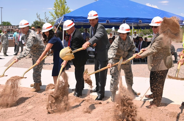 KIRTLAND AIR FORCE BASE, N.M. – District Commander Lt. Col. Patrick Dagon, far left, joins Sen. Martin Heinrich (4th from left) and Maj. Gen. Sandra Finan, commander of the Air Force Nuclear Weapons Center, to ceremonially break ground on Phase 2 of the Air Force Nuclear Weapons Center expansion, June 29, 2015.