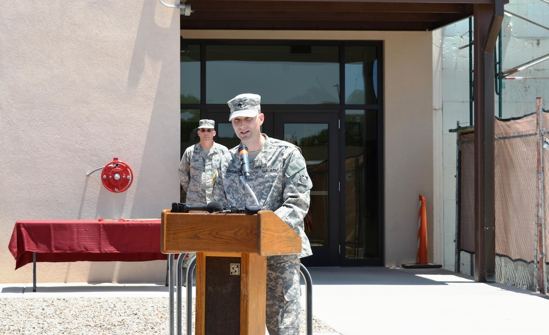 KIRTLAND AIR FORCE BASE, N.M. – District Commander Lt. Col. Patrick Dagon speaks at the ribbon-cutting ceremony to officially open Phase 1 of the Air Force Nuclear Weapons Center expansion, June 29, 2015.