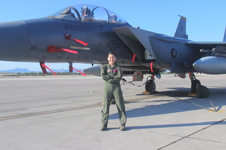 Capt. Kari Armstrong, an F-15E Strike Eagle weapon systems officer with the 389th Fighter Squadron, received more than a diploma from the U.S. Air Force Weapons School at Nellis Air Force Base, Nevada, June 27, 2015. Armstrong also became the first female F-15E weapons school officer and the second female student in a fighter platform -- after Col. Jeannie Leavitt in June 1998 -- to complete the graduate-level school. (Courtesy photo/Susan Garcia)