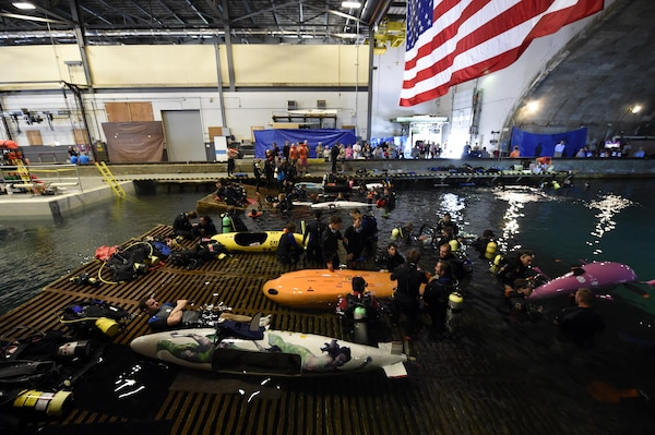 150624-N-PO203-128  BETHESDA, Md. (June 24, 2015) Competitors prepare their submarines during the 13th International Human-Powered Submarine Race (ISR) being held in the David Taylor Model Basin at the Naval Surface Warfare Center Carderock Division. The mission of the ISR is inspire students of various engineering disciplines to explore broad areas of underwater technology advancement, foster advances in subsea vehicle hydrodynamic, propulsion and life support systems and to increase the public awareness of the challenges people face in working in the and exploring the ocean depths. (U.S. Navy photo by John F. Williams/Released)
