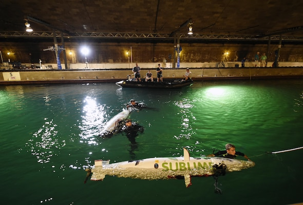 150624-N-PO203-076  BETHESDA, Md. (June 24, 2015) Navy divers from the Explosive Ordnance Disposal Technical Division at Indian Head, Md., assist student teams with their human-powered submarines during the 13th International Human-Powered Submarine Race (ISR) being held in the David Taylor Model Basin at the Naval Surface Warfare Center Carderock Division. ISR is a unique international engineering design competition that inspires high school and college-age students of the various engineering disciplines to pursue careers in science, technology, engineering and mathematics (STEM). (U.S. Navy photo by John F. Williams/Released)