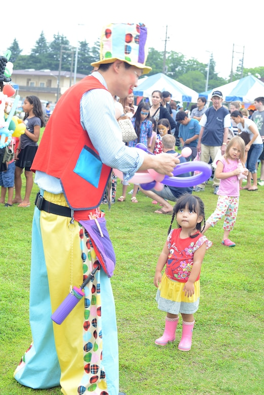 Travis Weaver shows national pride during Celebrate America at Yokota Air Base, Japan, July 2, 2015. The annual event provided military members and their families the opportunity to enjoy games, food and music culminating in a fireworks display over the Yokota airfield to celebrate Independence Day. (U.S. Air Force photo by Airman 1st Class David C. Danford/Released)