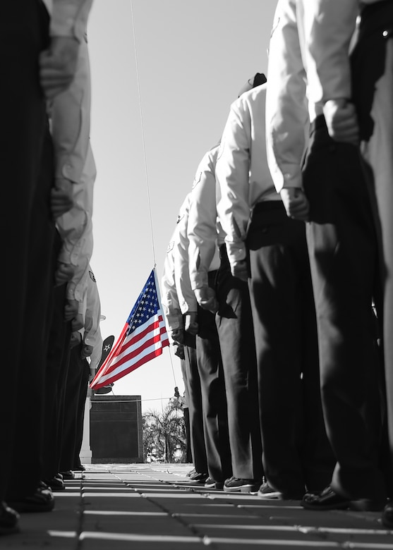Members of the 747th Communications Squadron stand at attention prior to a Reveille ceremony on Joint Base Pearl Harbor-Hickam, Hawaii, July 2, 2015. The ceremony was held to honor the upcoming Fourth of July holiday. This year, the United States of America celebrates 239 years of independence.  (U.S. Air Force illustration by Tech. Sgt. Aaron Oelrich/Released)