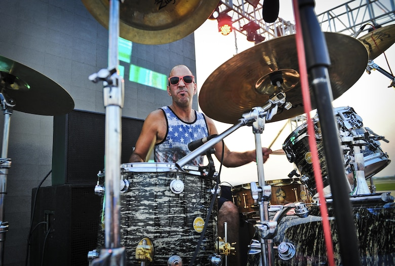 Mike Cosgrove, Alien Ant Farm drummer, smirks at the photographer during a song at the Liberty Fest concert July 4, 2015 at Osan Air Base, Republic of Korea. Alien Ant Farm was at Osan AB in part of the Liberty Fest entertainment, in celebration of Independence Day. (U.S. Air Force photo/Tech. Sgt. Travis Edwards)