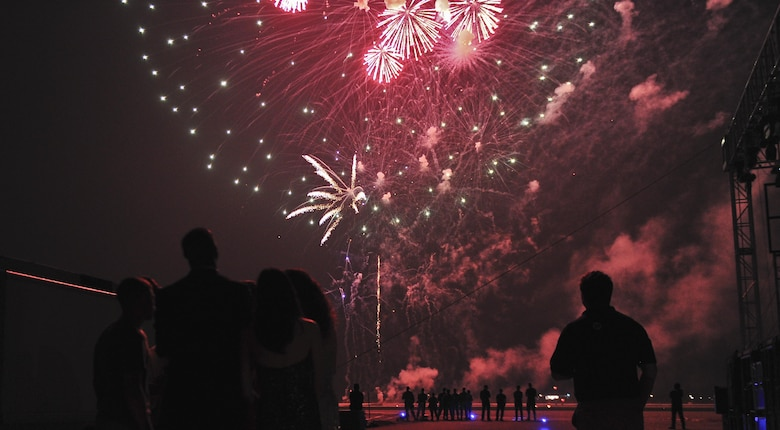 Airmen and entertainers gaze as the fireworks ignite over the skies Osan Air Base, Republic of Korea, July 4, 2015, in celebration of Independence Day. The fireworks presentation was one of the last displays of entertainment for a crowd of more than 5,000 during the festival. (U.S. Air Force photo by Tech. Sgt. Travis Edwards/Released)