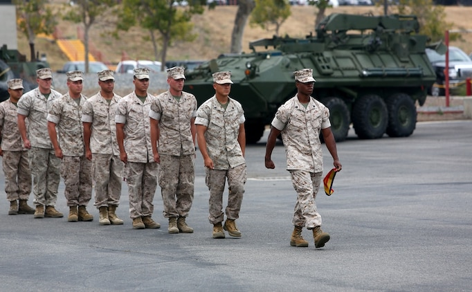 Marines with 1st Light Armored Reconnaissance Battalion, 1st Marine Division, line up to participate in the battalion's 30th anniversary rededication ceremony aboard Marine Corps Base Camp Pendleton, Calif., July 1, 2015. The Marines each carried forth one of the battalion's battle streamers to be placed upon the organizational colors by the commanding officer. (U.S. Marine Corps photo by Staff Sgt. Bobbie A. Curtis)