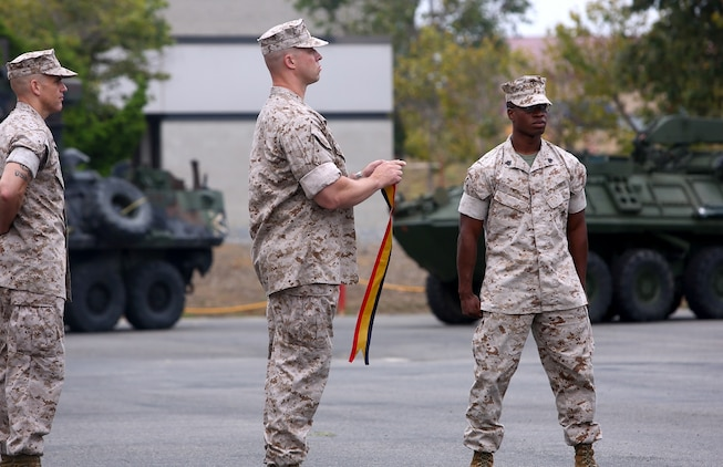 Lt. Col. Christian M. Rankin, commanding officer, 1st Light Armored Reconnaissance Battalion, prepares to place a battle streamer on the battalion's organizational colors during the its 30th anniversary rededication ceremony, aboard Marine Corps Base Camp Pendleton, Calif., July 1, 2015. After the ceremony, the Marines and Sailors of the battalion hiked to a nearby beach and held the annual Highlander Games Warrior Night. (U.S. Marine Corps photo by Staff Sgt. Bobbie A. Curtis)