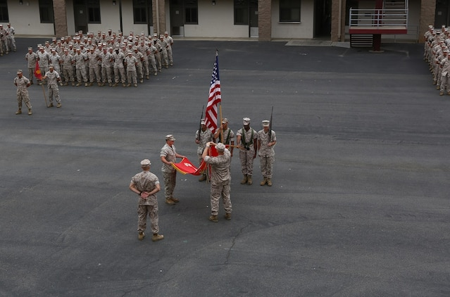 Lt. Col. Christian M. Rankin, commanding officer, 1st Light Armored Reconnaissance Battalion, places a battle streamer on the battalion's organizational colors during the 30th anniversary rededication ceremony aboard Marine Corps Base Camp Pendleton, Calif., July 1, 2015. After the ceremony, the Marines and Sailors of the battalion hiked to a nearby beach and held the annual Highlander Games Warrior Night. (U.S. Marine Corps photo by Staff Sgt. Bobbie A. Curtis)