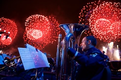Senior Master Sgt. Brian Sands performs during the 2015 Macy's fireworks celebration in Hunter's Point South Park in Long Island on the Fourth of July.  The Ceremonial Brass, Concert Band, Singing Sergeants and Strolling Strings combined forces to execute the largest mobilization in the units history. (U.S. Air Force photo by Senior Master Sgt. Bob Kamholz/released)