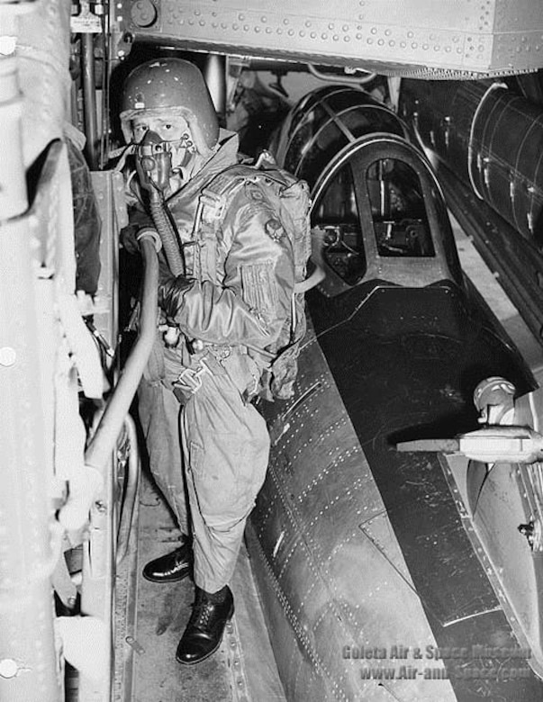 Maj. Clyde Good, FICON test pilot, working his way from the cockpit of the YRF-84F Thunderflash to the camera compartment. The final FICON evaluation flight of the YRF-84F was flown on June 9, 1954. (U.S. Air Force photo)