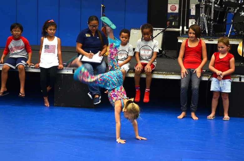 Children participate in a freestyle dance competition at Freedom Fest July 3, 2015, at Andersen Air Force Base, Guam. Freedom Fest 2015 brought approximately 200 Andersen AFB Airmen and their families together to celebrate Independence Day. (U.S. Air Force photo by Airman 1st Class Alexa Ann Henderson/Released)