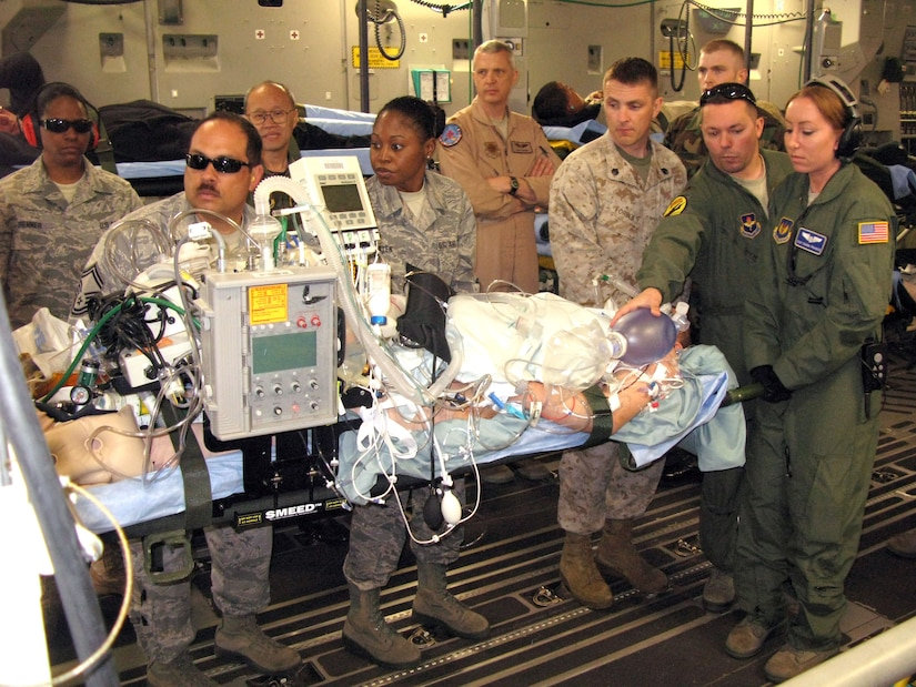 U.S. Air Force aeromedical evacuation crewmembers and volunteers at Ramstein Air Base, Germany, position a critically wounded warrior for a flight aboard a C-17 Globemaster III to Joint Base Andrews, Maryland, April 29, 2011. (U.S. Air Force photo by Donna Miles)