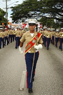 U.S. Marine Master Gunnery Sgt. Mark Gleason, bandmaster, U.S. Marine Corps Forces, Pacific Band performs during His Majesty's Birthday Parade in Nuku'alofa, Tonga July 8, 2015. The MARFORPAC Band travels throughout the Pacific region to promote community relations and interoperability between the U.S. and other countries.