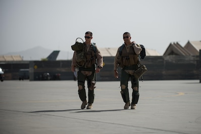 U.S. Air Force Brig. Gen. Dave Julazadeh, right, 455th Air Expeditionary Wing commander, and another F-16 Fighting Falcon aircraft pilot walk towards their jets at Bagram Airfield, Afghanistan, July 7, 2015. The F-16 is a multi-role fighter aircraft that is highly maneuverable and has proven itself in air-to-air and air-to-ground combat. (U.S. Air Force photo by Tech. Sgt. Joseph Swafford/Released)