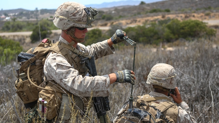 Corporal Russell Robertson, a squad leader assigned to Company I, 3rd Battalion, 5th Marine Regiment, extends the antenna for his radio operator during the 1st Marine Division Super Squad Competition aboard Marine Corps Base Camp Pendleton, Calif., June 30, 2015. The Marines and Sailors tested their abilities to conduct infantry operations for the title of super squad.