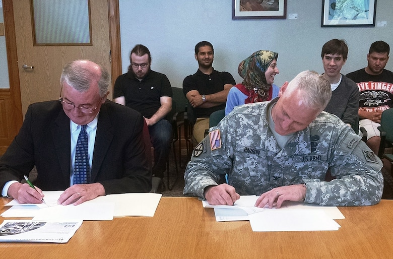 Col. Christopher Barron, New England District Commander, entered into an education partnership agreement with MassBay Community College, May 26, 2015. Col. Barron and John O'Donnell, President of MassBay Community College signed the agreement at the Wellesley, Massachusetts Campus
