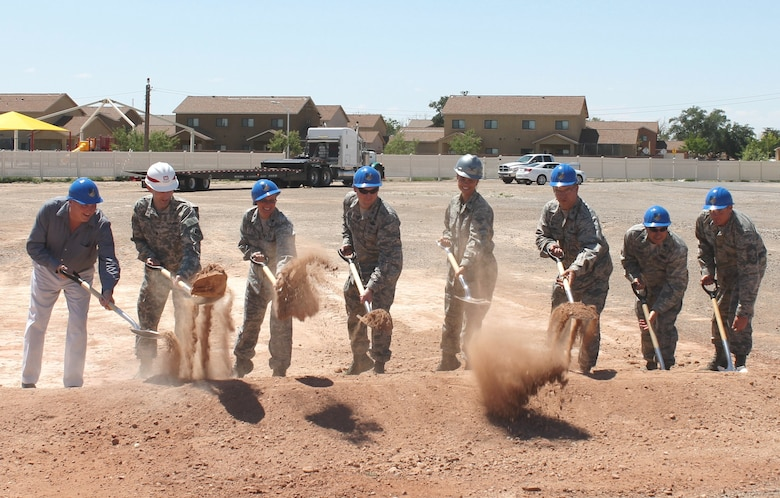 HOLLOMAN AIR FORCE BASE, N.M. – District Commander Lt. Col. Patrick Dagon (second from left) joins Lt. Col. Kathleen Mackey, commander of the 49th Medical Support Squadron (third from left); and Col. Leslie Knight, commander of the 49th Medical Group (fifth from left) to break ground on the new medical clinic at the base, July 1, 2015.