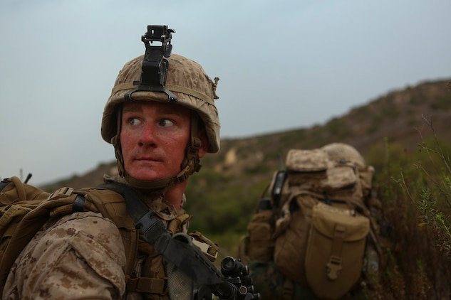 Lance Cpl. Cory Mersino, a team leader assigned to Company I, 3rd Battalion, 5th Marine Regiment, looks over his shoulder at his surroundings during a patrol as part of the 1st Marine Division Super Squad Competition aboard Marine Corps Base Camp Pendleton, Calif., June 30, 2015. The Marines and Sailors tested their abilities to conduct infantry operations for the title of super squad.