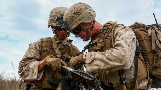 Lance Cpl. Cory Mersino, a fire team leader and Lance Cpl. Chad Conlee, a rifleman, both assigned to Company I, 3rd Battalion, 5th Marine Regiment, navigate during the patrol portion of the 1st Marine Division Super Squad Competition aboard Marine Corps Base Camp Pendleton, Calif., June 30, 2015. The Marines and Sailors tested their abilities to conduct infantry operations for the title of super squad.