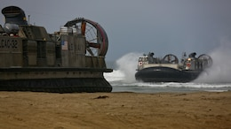 U.S. Navy Landing Craft Air Cushioned (LCAC) vehicle from Assault Craft Unit 5 lands on Red Beach as part of a loading exercise along side Combat Logistics Battalion 11, Headquarters Regiment, 1st Marine Logistics Group at Marine Corps Base Camp Pendleton, California, June 23, 2015. This loading exercise reinforces the Marine Corps role as an amphibious force in readiness by maintaining capabilities through realistic training.