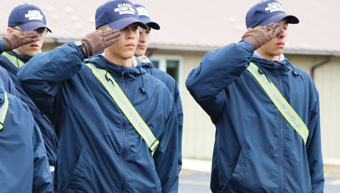 Alaska Military Youth Academy cadets salute during a uniform inspection. The AMYA Challenge program is a 17.5 month, quasi-military residential and non-residential high school which uses military values and methodology to reclaim the lives of Alaska's at-risk youth. (Courtesy photo from Roman Schara)