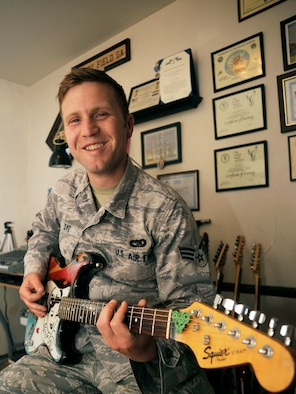 Senior Airman Richard Dye, 30th Logistics Readiness Squadron vehicle maintenance journeyman, practices guitar in his home recording studio, July 8, 2015, Vandenberg Air Force Base, Calif.  While not the most grandiose of studios, it is enough for Dye to create punk-inspired ballads and share them with the world via social media. (U.S. Air Force photo by Airman 1st Class Ian Dudley/Released)
