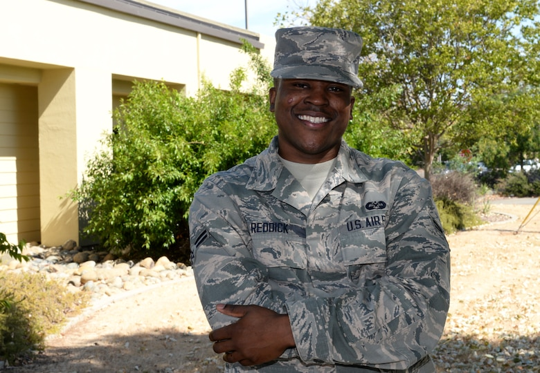 Airman 1st Class Willis Reddick, 9th Reconnaissance Wing Staff Judge Advocate civil law paralegal, poses for a photo July 7, 2015, at Beale Air Force Base, California. (U.S. Air Force photo by Airman 1st Class Ramon A. Adelan)