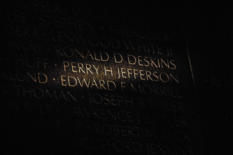 U.S. Air Force Maj. Perry Jefferson's name is etched into the Vietnam Veteran's Memorial in Washington, D.C. Jefferson, an intelligence officer with Colorado Air National Guard's 120th Tactical Fighter Squadron, went missing in action in Vietnam April 3, 1969, while working as an aerial observer on board an O-1G Bird Dog aircraft over a mountainous region in Ninh Thuan Province. His remains were interred at Arlington National Cemetery in Arlington, Va., April 3, 2008. In the weeks leading to Memorial Day 2008, the cross next to his name on the wall was etched into a diamond, signifying his belated repatriation. (U.S. Air National Guard photo by 1st Lt. Darin Overstreet)