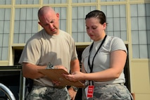 Tech. Sgt. Charles McAllister, 2nd Operations Support Squadron NCO in charge of systems and mobility readiness, and Senior Airman Emily Boudreaux, 2nd OSS systems and mobility readiness journeyman, review a checklist at Barksdale Air Force Base, La., July 7, 2015. The checklist identifies equipment Intel Airmen will need to provide information to B-52H Stratofortress aircrews regarding threat information, targeting locations and more. (U.S. Air Force photo/Senior Airman Benjamin Raughton)