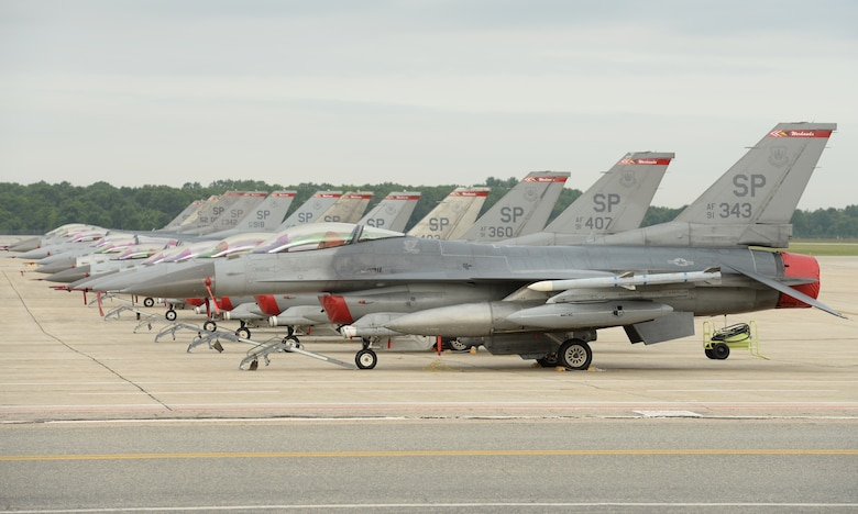 F-16C Fighting Falcons from the 52nd Fighter Wing Spangdahlem Air Base Germany line the flightline at Pease Air National Guard Base, N.H., on July 7, 2015.  A contingent of the Spangdahlem-based aircraft landed at Pease while in transit to a training exercise in the United States. The 52 FW supports the supreme allied commander Europe with mission-ready personnel and systems providing expeditionary air power for suppression of enemy air defenses, close air support, air interdiction, counter air, air strike control, strategic attack, combat search and rescue, and theater airspace control. The wing also supports contingencies and operations other than war as required. (U.S. Air National Guard Base photo by Staff Sgt. Curtis J. Lenz)