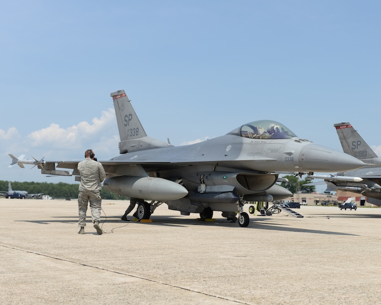 U.S. Air Force Airman from the 480th Aircraft Maintenance Unit, 52nd Aircraft Maintenance Squadron Spandahlem Air Base, Germany work on their F-16C Fighting Falcon at Pease Air National Guard Base, N.H., on July 6, 2015.  A contingent of the Spangdahlem-based aircraft landed at Pease while in transit to a training exercise in the United States.  The 52 FW supports the supreme allied commander Europe with mission-ready personnel and systems providing expeditionary air power for suppression of enemy air defenses, close air support, air interdiction, counter air, air strike control, strategic attack, combat search and rescue, and theater airspace control. The wing also supports contingencies and operations other than war as required.  (U.S. Air National Guard photo by Staff Sgt. Curtis J. Lenz)