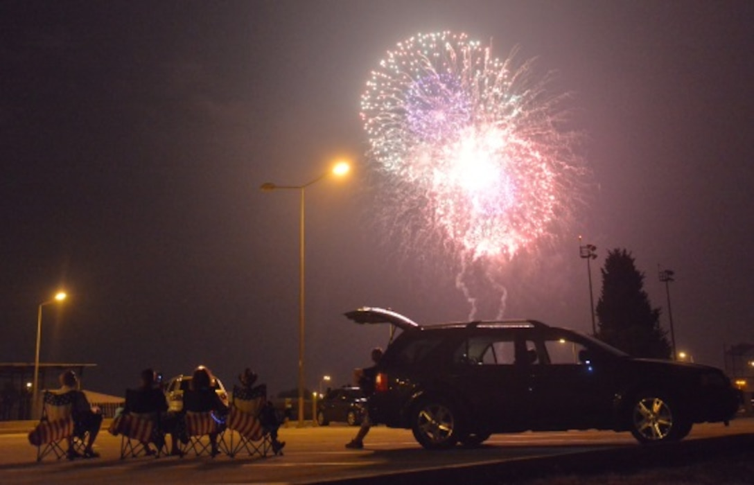 Members of Team Incirlik watch a firework display during a 4th of July Festival July 4, 2015, at Incirlik Air Base, Turkey. Festival events included a pie eating contest, raffle, food and beverage booths, fireworks and a performance by special guest Alaina Blair, American singer and Armed Forces Entertainment performer. (U.S. Air Force photo by Senior Airman Michael Battles/Released)