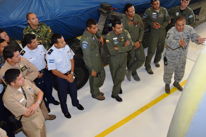Master Sgt. Carlos Medrano Jr.(right), aircraft engine supervisor with the 433rd Maintenance Squadron, explains the repair process of the engines on the C-5A Galaxy aircraft to students from Inter-American Air Forces Academy at Joint Base San Antonio-Lackland, Texas, July 8, 2015. Since 1942, IAAFA has conducted international training in the Spanish language, forging ties with Latin American military, national police and governmental agencies. (U.S. Air Force photo/Tech Sgt. Carlos J. Trevino)