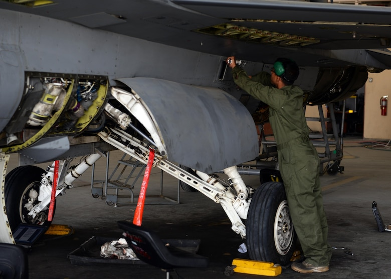 U.S. Air Force Senior Airman Omar Segusulaiman, 455th Expeditionary Aircraft Maintenance Squadron F-16 aircraft maintainer, works on a jet during a routine phase inspection July 7, 2015, at Bagram Airfield, Afghanistan. The team, who has been deployed to BAF for two months, is working on their 12th phase inspection that occurs after a jet has reached 400 flying hours. (U.S. Air Force photo by Senior Airman Cierra Presentado/Released)