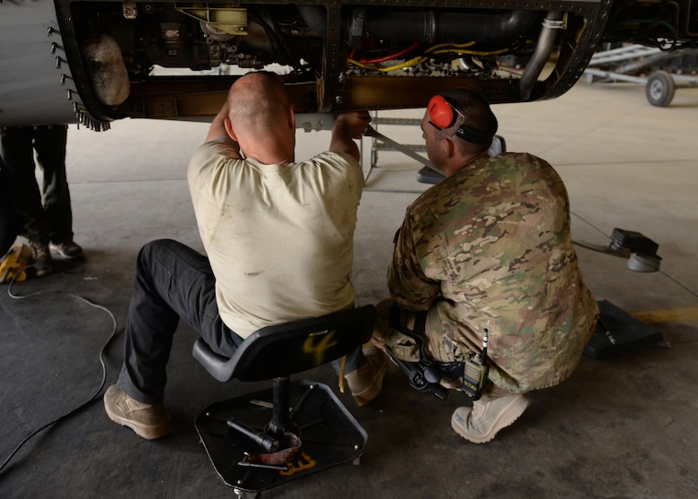 U.S Air Force Staff Sgt. William Hogarth (left) and TSgt. Charles Nichols, 455th Expeditionary Aircraft Maintenance Squadron F-16 aircraft maintainers inspects parts of a jet after taking it apart during a phase inspection July 7, 2015, at Bagram Airfield, Afghanistan. The phase inspection team, who has been deployed to BAF for two months, is working on their 12th phase inspection that occurs after a jet has reached 400 flying hours. (U.S. Air Force photo by Senior Airman Cierra Presentado/Released)