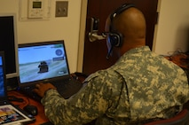 A U.S. Army military policeman conducts training and assessment of Virtual Battle Space 3 in support of joint non-lethal weapons escalation of force scenarios.