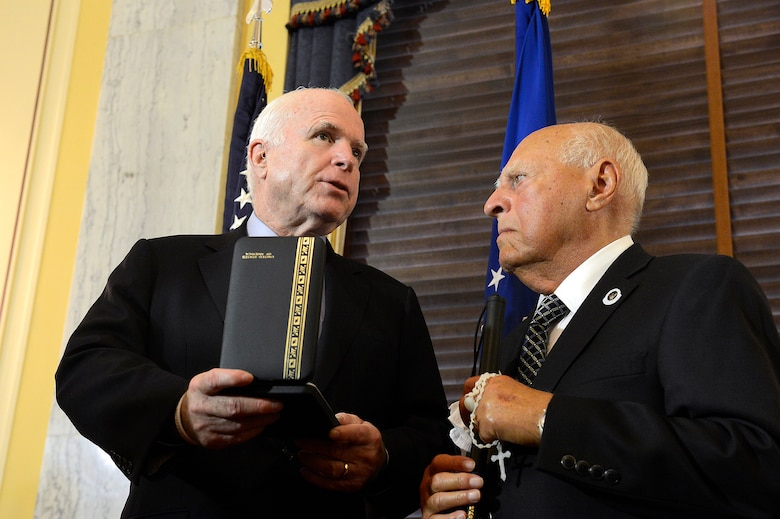 Sen. John McCain, R-Ariz. congratulates 1st Lt. John Pedevillano, a WWII Army-Air Force B-17 bombardier, during a ceremony in his honor, in Washington, D.C., July 7, 2015. Air Force Vice Chief of Staff Gen. Larry O. Spencer and McCain presented Pedevillano with the Presidential Unit Citation award, as the last survivor of his WWII unit.  (U.S. Air Force photo/Scott M. Ash)