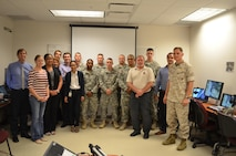 The Simulator Assessment Working Group, based in Orlando, Florida, gathers for the Army Distributed Soldier Training System assessment of joint non-lethal weapons escalation of force scenarios.
