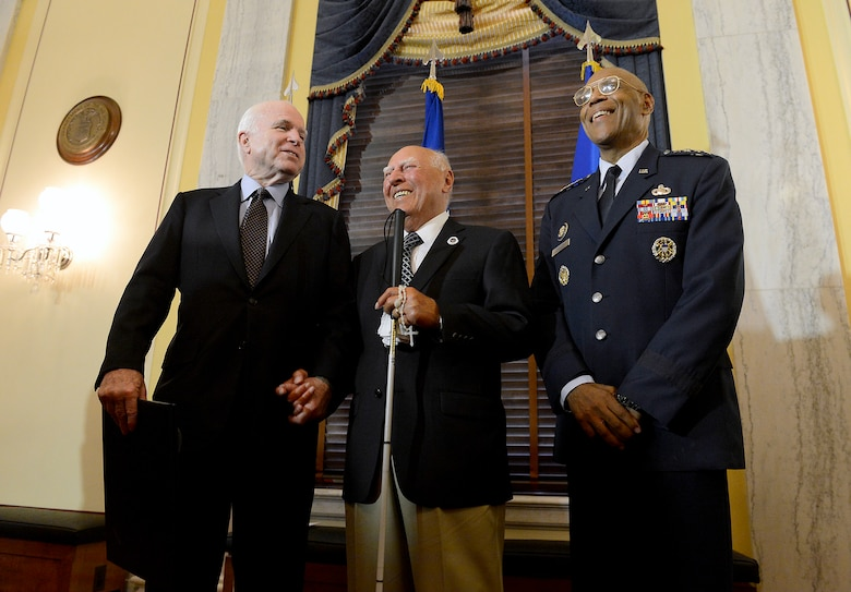 Sen. John McCain and Air Force Vice Chief of Staff Gen. Larry O. Spencer congratulate 2nd Lt. John Pedevillano, a WWII Army Air Corps B-17 bombardier, during a ceremony in his honor, in Washington, D.C., July 7, 2015. McCain and Spencer presented Pedevillano with the Presidential Unit Citation with one oak leaf cluster. He is the last survivor of his WWII unit. (U.S. Air Force photo/Scott M. Ash)