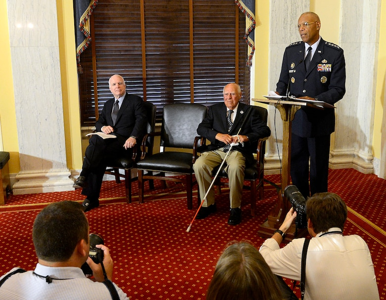 Air Force Vice Chief of Staff Gen. Larry O. Spencer meets with 2nd Lt. John Pedevillano, third from left, a WWII Army Air Corps B-17 bombardier, with his son-in-law William Lucci, and Sen. John McCain, in Washington, D.C., July 7, 2015. Spencer and McCain presented Pedevillano with the Presidential Unit Citation with one oak leaf cluster. He is the last survivor of his WWII unit. (U.S. Air Force photo/Scott M. Ash)